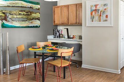 a built-in desk nook is adjacent to the dining room in the Fitzsimons South apartment home.