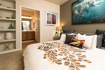 Premium Fitzsimons South apartment home bedroom with private bathroom.
