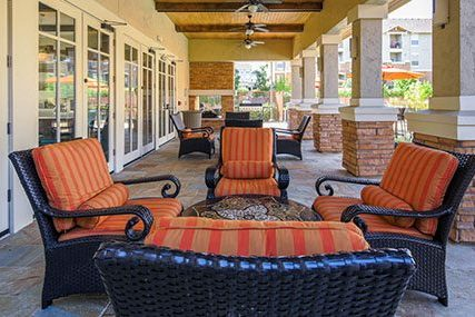 Inviting outdoor lounge areas at the Griffis Fitzsimons South apartment homes community clubhouse patio.