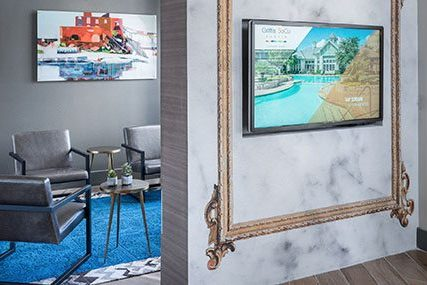 Large interactive touch screen in the Griffis Residential SoCo Austin community clubhouse.