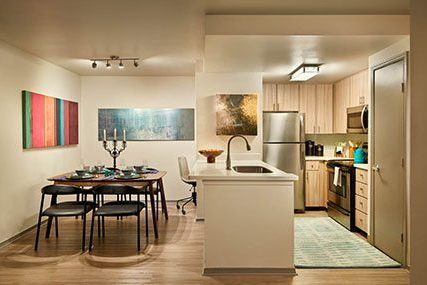 Open-concept kitchen and dining room Griffis Residential North Creek apartment home.