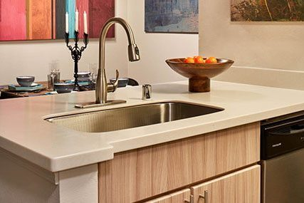 Close-up of sink in a North Creek apartment home open-concept kitchen.