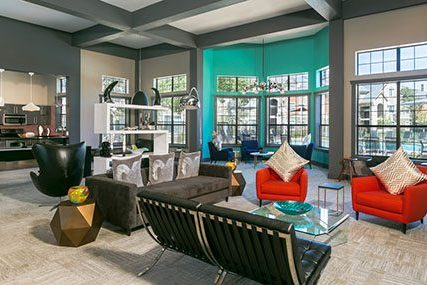 Inviting lounge area and large windows in the Griffis Westminster Center clubhouse