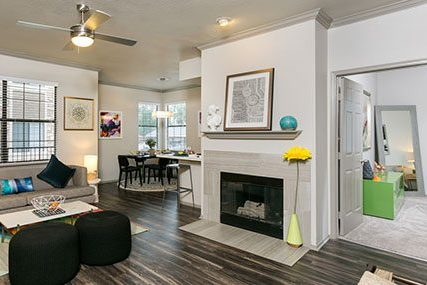 Spacious Griffis Westminster Center living room with fireplace, and double-paned windows