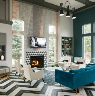 Modern Lounge with Fireplace on Sagebrook Apartment Clubhouse - Colorado Springs
