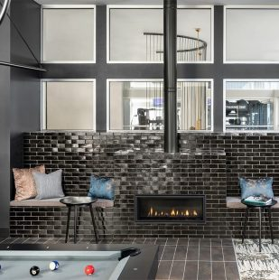 Griffis Cherry Creek Renovated Resident Lounge with open kitchen, fire place and game table