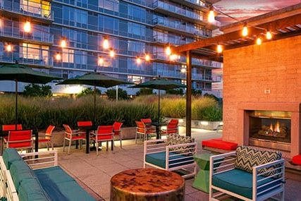 outdoor fireplace lounge at Griffis South Waterfront apartments in Portland