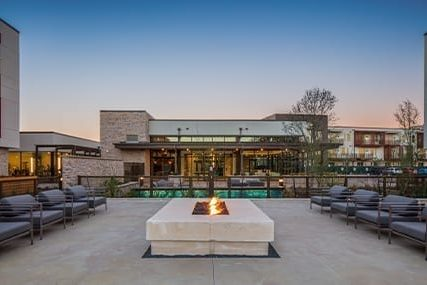 outdoor fireplace at Griffis Riata apartments in Austin