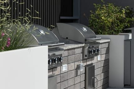 outdoor grilling area at Griffis Cherry Creek North apartments in Denver